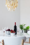 Elegant table with red wine and fruits stock image