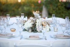 Elegant table scape with flowers royalty free stock images