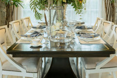 Elegant table set in classic style dining room Stock Images