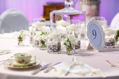 Elegant table set in green and white for wedding or event party. Stock Images