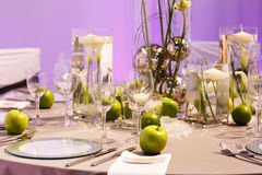 Elegant table set in green and white for wedding or event party. Stock Photo