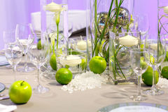 Elegant table set in green and white for wedding Stock Images