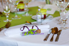 Elegant table set in lilac and green for wedding or event party Stock Images