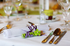 Elegant table set in lilac and green for wedding or event party Royalty Free Stock Photography