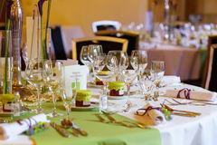 Elegant table set in lilac and green for wedding or event party Stock Photos