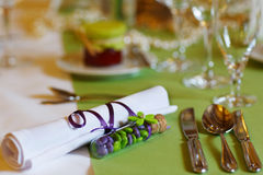 Elegant table set in lilac and green for wedding or event party Royalty Free Stock Photo