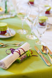 Elegant table set in lilac and green for wedding or event party Royalty Free Stock Photos