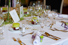 Elegant table set in lilac and green for wedding or event party Stock Photography