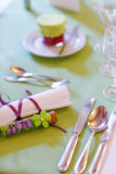 Elegant table set in lilac and green for wedding or event party Stock Image