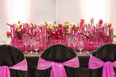 Elegant table set in pink for wedding or event party. Elegant table set with flowers in pink for wedding or event party Stock Image