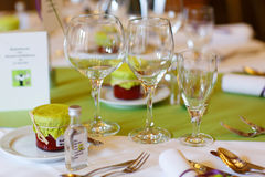 Elegant table set in purple and green for wedding or event party Royalty Free Stock Photo