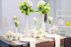 Elegant table set in soft creme for wedding or event party. Royalty Free Stock Images