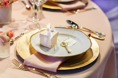 Elegant table set in soft creme for wedding or event party. Stock Photography