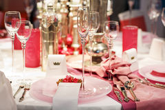 Elegant table set in soft red and pink for wedding or event part Stock Images