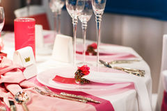 Elegant table set in soft red and pink for wedding or event part Royalty Free Stock Images