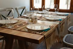Elegant table set in traditional restaurant. Mix between rustic and modern tableware design royalty free stock photo