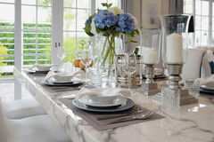 Elegant table set in vintage style dining room Stock Images