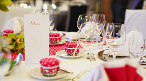 Elegant table set  for wedding or event party in pink with dots. Royalty Free Stock Images