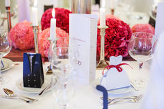 Elegant table set  for wedding or event party in soft red and pi. Nk, with paper bride and groom Stock Images