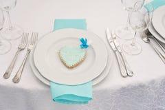 Elegant table set at. Wedding reception. Elegant table set with cookie gift with monogram at fine restaurant. Wedding reception Stock Image