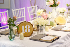Elegant table set in white for wedding or event party. Royalty Free Stock Photo