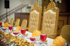 Elegant table setting. Elegant seating and place settings around a banquet table Stock Image