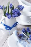 Elegant table setting with beautiful blue flowers muscari Stock Photography