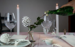 Elegant table setting. Christmas. romantic dinner - tablecloth, cutlery, candles, flowers, buds. Stock Photography