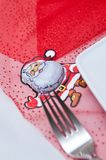 Christmas table setting with white plates and red decorations Stock Images