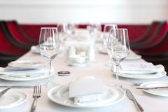 Elegant table setting with crystal glasses royalty free stock image