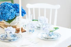 Elegant table setting with flowers Stock Photo