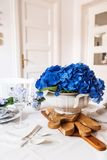 Elegant table setting with flowers Stock Images