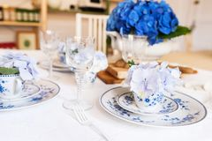 Elegant table setting with flowers Stock Photos