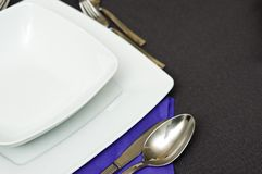 Elegant table setting with violet napkin stock image