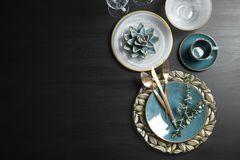 Elegant table setting and space for text on dark background. Top view stock photos