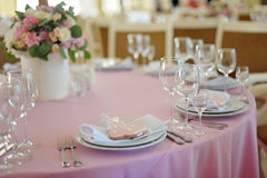 Elegant table setting with tasty gift. Elegant table setting with cookie gift in heart form at fine restaurant. Wedding reception Royalty Free Stock Images