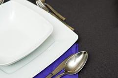 Elegant table setting with violet napkin stock image