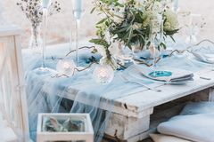 Elegant table setup in blue pastels for a beach wedding stock photos