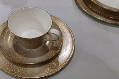 Elegant table tea set in modern style cups and plates royalty free stock photography