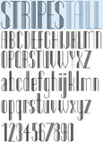 Elegant Tall Striped retro style artistic font. Stock Images