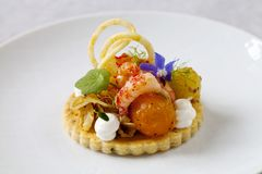 Elegant tart with crayfish. Thyme tart with crayfish, goat cheese mousse, fennel, tomatoes and crispy potato royalty free stock photography