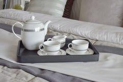 Elegant tea cup set on black tray in modern bedroom Royalty Free Stock Photos