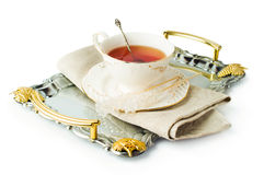 Elegant tea cup on a tray with sugar on a stick Royalty Free Stock Photo