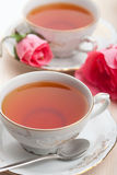 Elegant tea and roses stock photography