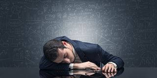Teacher fell asleep at his workplace with full draw blackboard concept. Elegant teacher fell asleep at his workplace with full draw blackboard concept stock photo