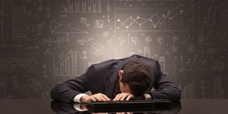Teacher fell asleep at his workplace with full draw blackboard concept. Elegant teacher fell asleep at his workplace with full draw blackboard conceptn royalty free stock photo