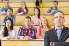 Elegant teacher with students at the lecture hall Stock Photos