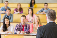 Elegant teacher with students at the lecture hall Stock Image