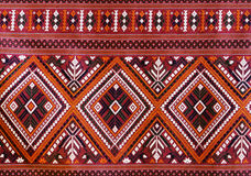 The Elegant Thai art on hand-woven fabrics stock photography