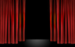 Elegant theater stage with red velvet curtains Stock Images